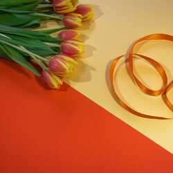 greeting e-card Bouquet of tulips on an orange-yellow background